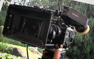 Back behind the lens